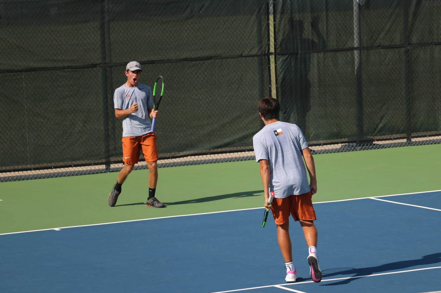 Celebrating+a+hard+earned+point%2C+Daniel+Antov+%2721+and+Marko+Mesarovic+%2723+look+to+each+other+to+express+their+excitement.+The+duo+would+go+on+to+win+their+match++by+a+score+of+6-4%2C+7-6%2C+and+a+tie-breaker+of+10-4.+