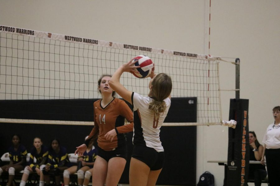 Laure Giansanti 23 sets the ball to throw it over the net. After this, Stony Point won a point.