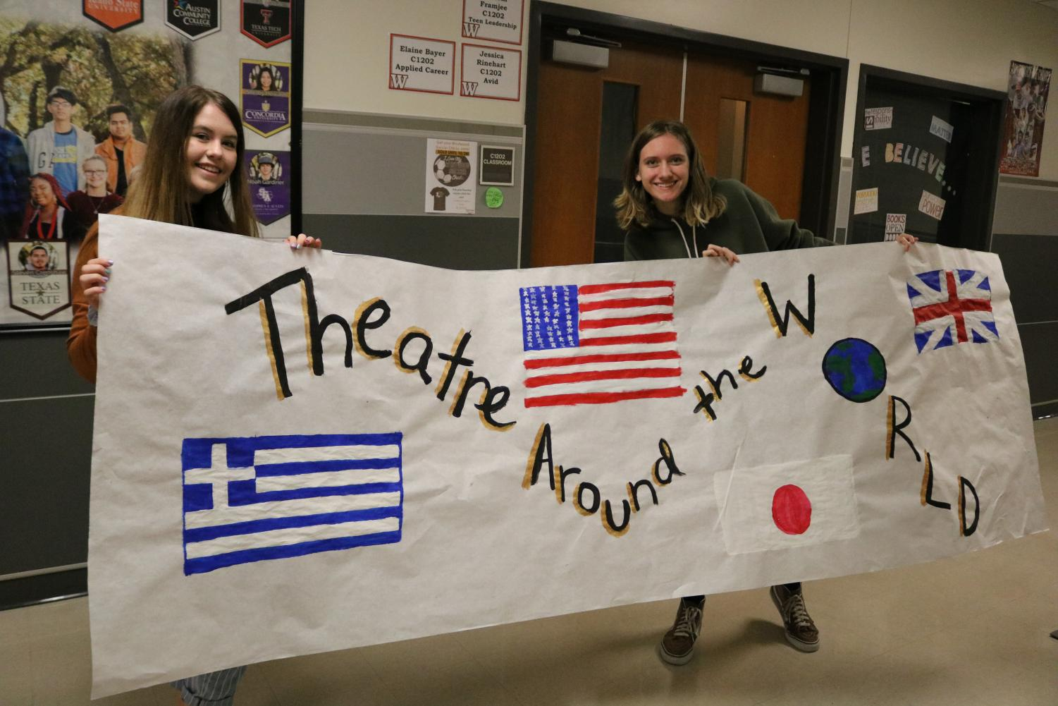 Drama+club+members+Eva+De+Guelle+%2722+and+Sophie+Clift+%2722+proudly+hold+their+poster+representing+theatre+in+all+the+countries.+They+want+to+highlight+the+different+forms+of+practicing+theatre+in+various+places+across+the+world.