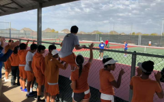 The varsity squad takes to the sidelines to cheer on their fellow teammates Varun Somarouthu '20 and Ani Margam '20. who'd go on to win their match. Photo courtesy of Ms. Ruma Nagar Singh.