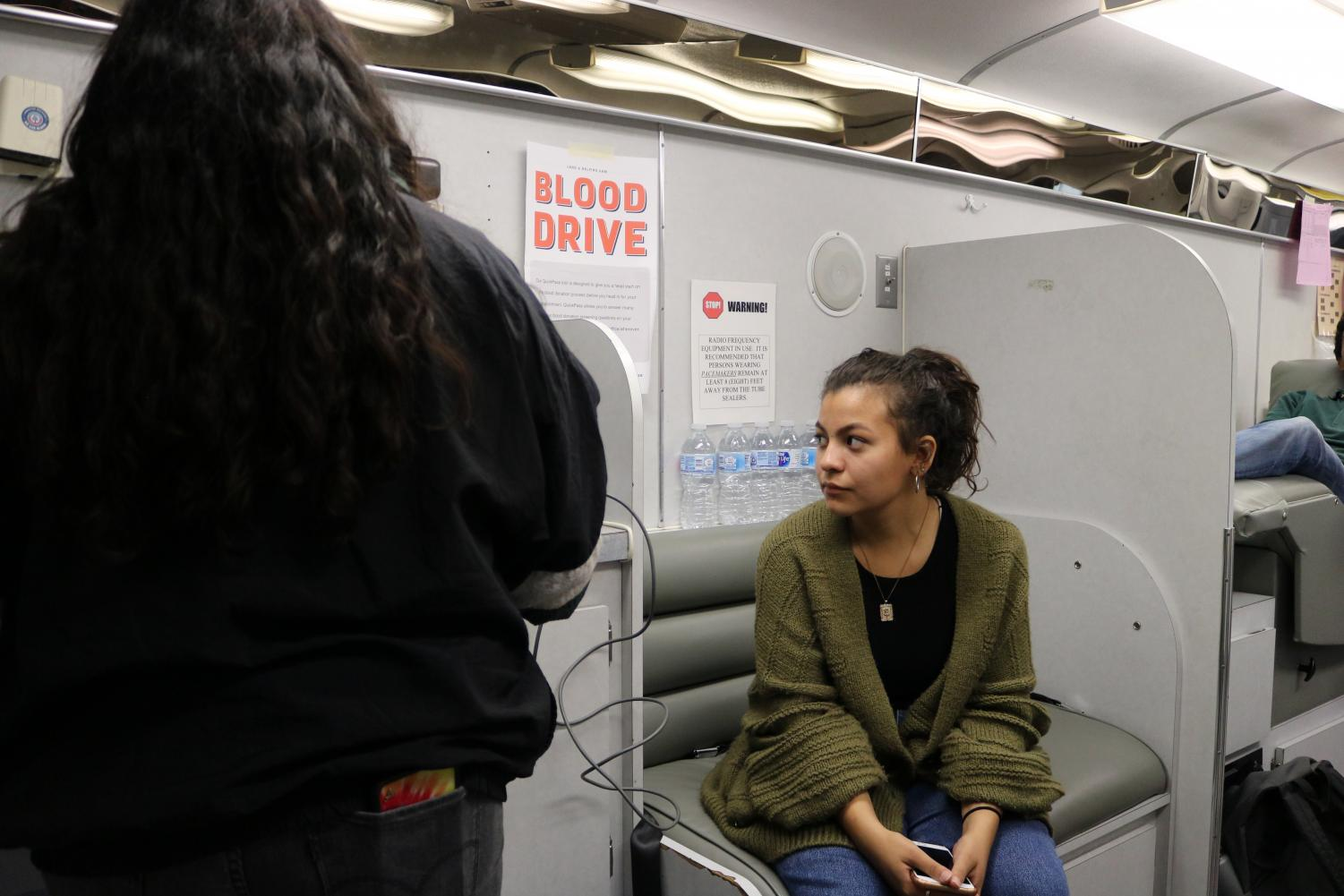Heather+Lobera+%2720+patiently+waits+for+a+blood+drive+helper+to+ask+her+questions+before+she+can+donate+blood.