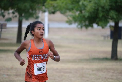 Deepti Choudhury '21 places 7th in the 6A girls race. Choudhury went out with the top pack, and held on to finish the 5K in 18 minutes and 20 seconds.