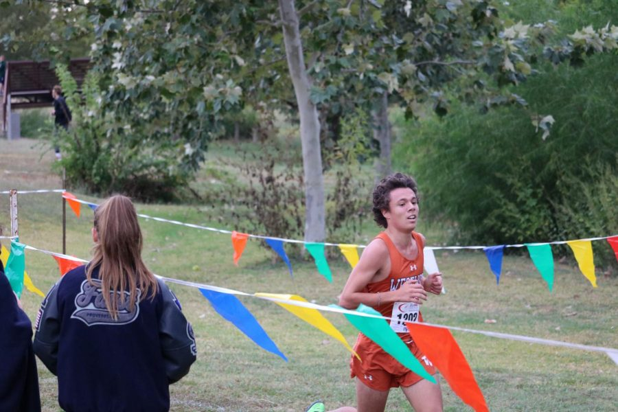 Pablo Lomeli '21 dashes towards the finish line. Lomeli started the race conservatively, crossing through the first mile barely in the top 50. He gradually pushed the pace to finish 19th overall.