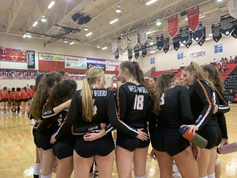 The Lady Warriors huddle up after Vista Ridge called a timeout. Head coach Tara Grant discussed with the athletes about their plays.