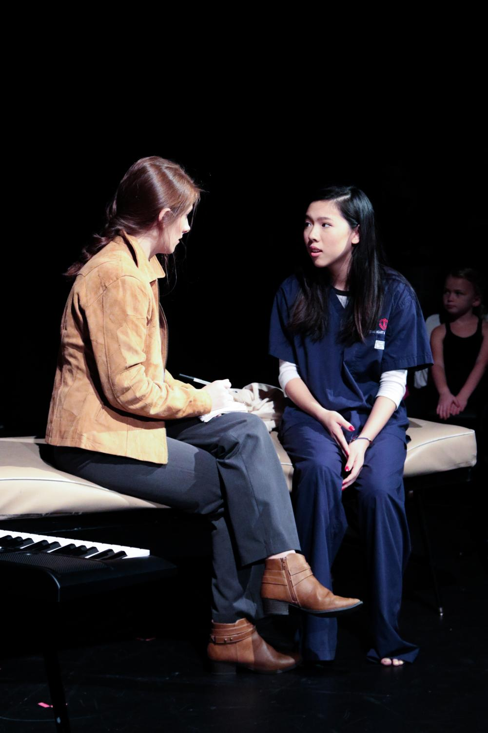 Rachel+Rusch+%2720+and+Lucy+Wang+%2720+act+as+their+characters+Heche+and+Angela+during+the+play+%27Trap%27.