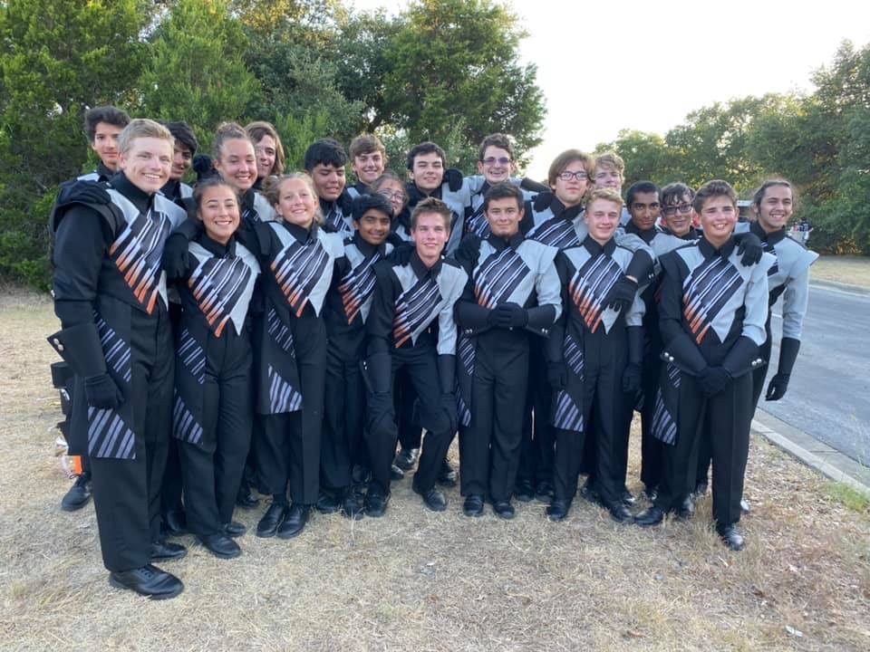The+trumpet+section+poses+for+a+photo+before+the+RRISD+Festival+of+Bands.+Soon+after%2C+they+began+to+stretch+and+prepare+for+their+run+inside+the+stadium.
