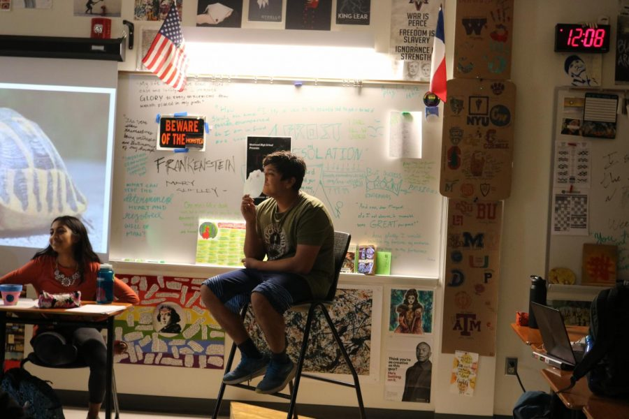 Acting as a turtle who is a witness for the humans monster, Rohan Dange '21 puts a mask over his face while he is questioned. Dange complains about the pollution and harm humans have caused in the ocean in an attempt to persuade the class that humans are the worst monsters.