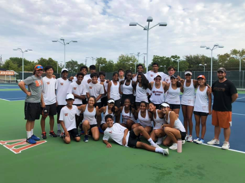 Varsity+tennis+poses+for+a+group+photo+following+a+staggering+overall+victory+of+12-0+against+Houston%27s+Tomball+Memorial+Wildcats.+This+victory+secures+the+team%27s+advancement+into+the+UIL+team+tennis+playoffs.+%0APhoto+courtesy+of+Ms.+Ruma+Nagar+Singh.+