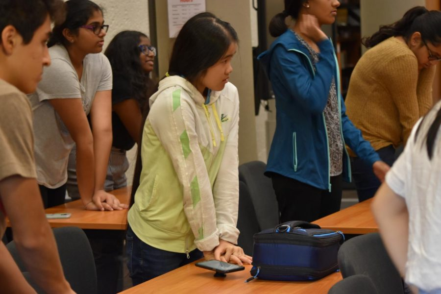 Following the instructions of the lecturer, Helen Huang '21 practices proper posture for applying pressure. Presenters demonstrated and helped students with practicing compression.