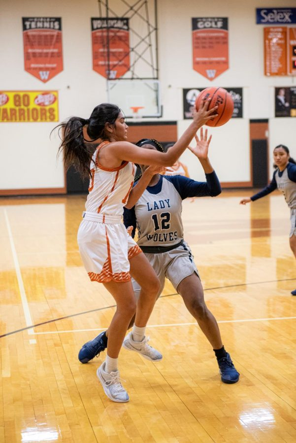 A defensive player on her back, Anisha Chintala '21 passes the ball to her teammate which led to another point for the Warriors. During the second quarter the Warriors were able to make up their score gap scoring a stunning 17 points.