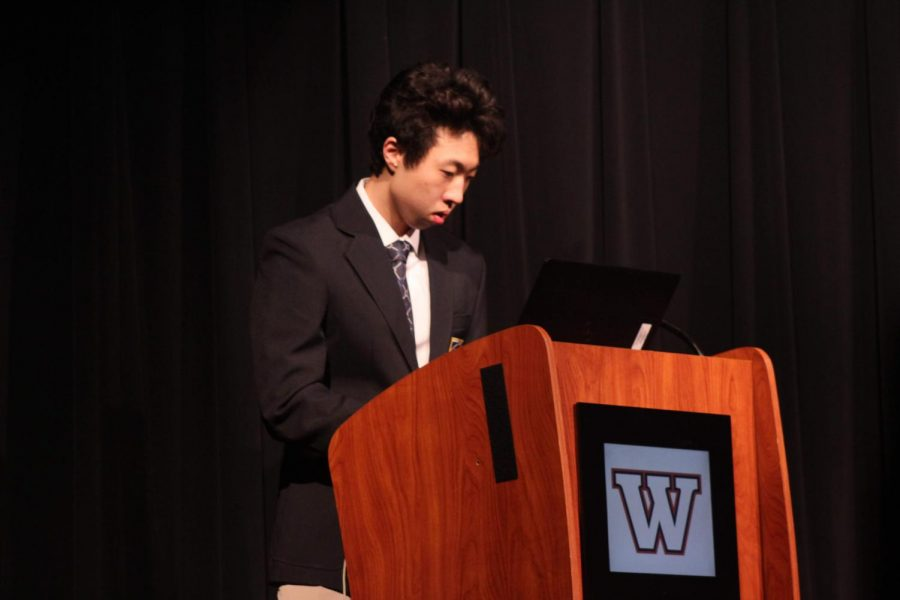 Bryan Chen '20 gets ready for the open ceremony for DECA day. The opening ceremony was held in order to orient students on where events would be held and provide extra information about the general activities of the day.