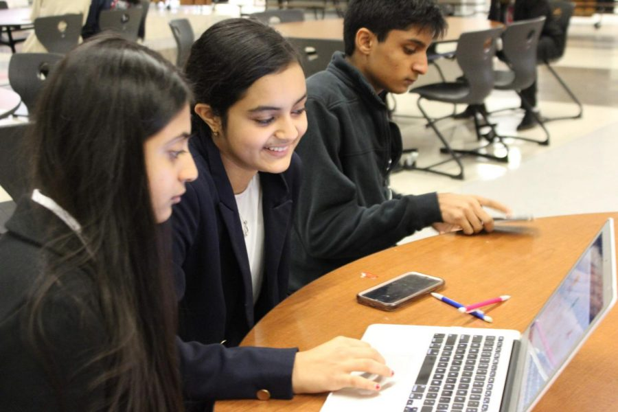 Before their role-play, Sakshi Dhavalikar 21 and Serena Manwani 22 practice using their computer. Dhavalikar and Manwani competed in the Sports and Entertainment Marketing Team Decision Making event.