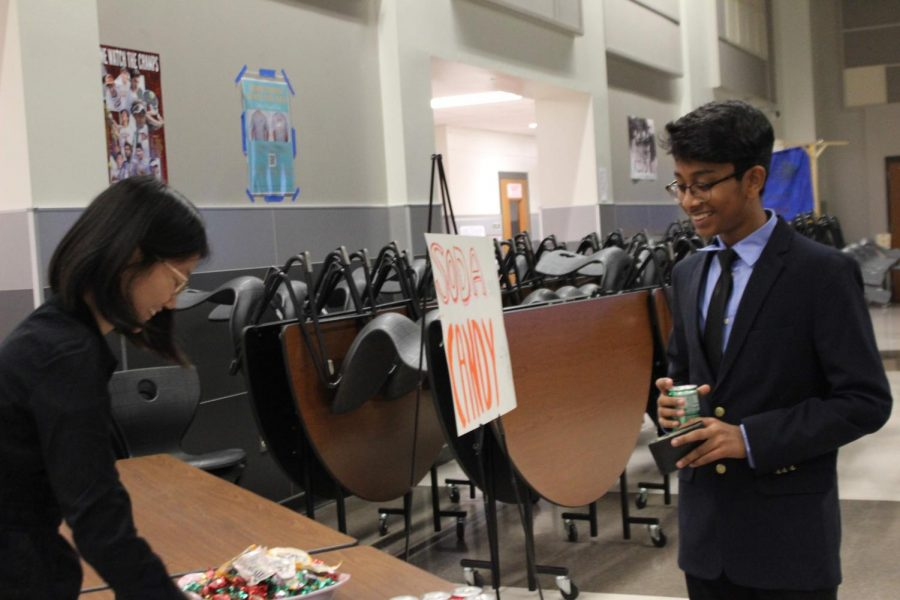 Denise Lin 21 sells soda to a student. As a part of her DECA project, Lin sold candy and soda to benefit the DECA organization.