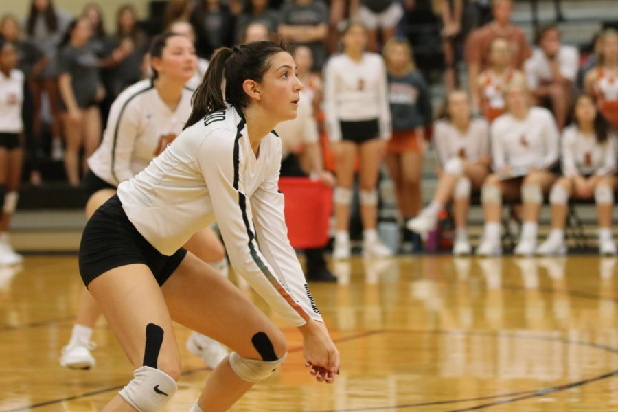 Receiving the other teams serve, Zoe Menendez '20 passes the ball up for someone else to hit. After graduation, Menendez will be heading to D1 school University of the Incarnate Word to continue her volleyball career.