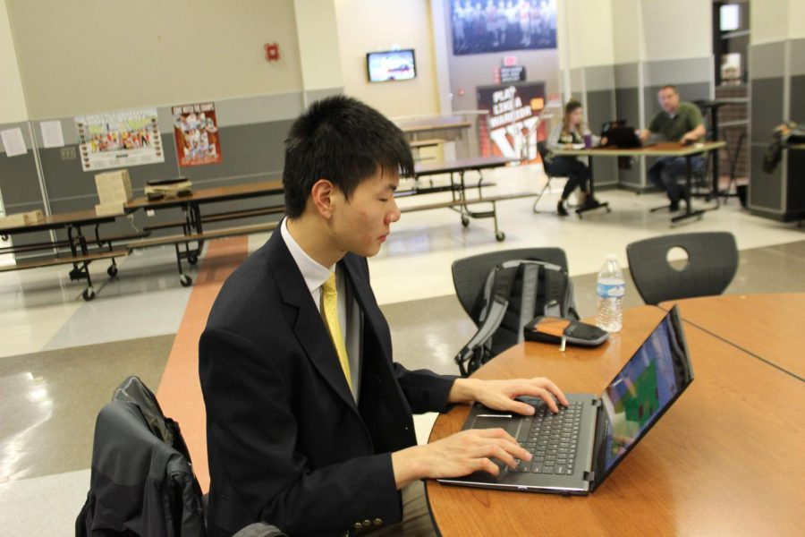 Chris Fan '20 studies after he finishes his role-play and testing. Fan competed in the Marketing Management Team Decision Making competition with Sathvik Allala '20 and came in first place.