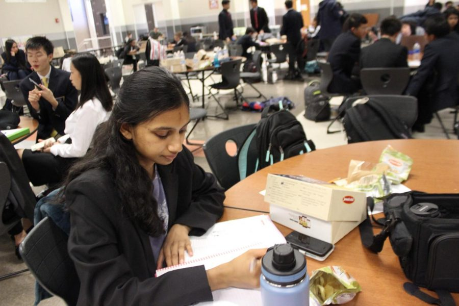 After competing and testing, Nivrithi Kuttuva 21 studies in the cafeteria. Kuttuva competed in the Marketing Management Team Decision Making event and placed 2nd overall with her partner, Srilekha Cherukuvada 21.