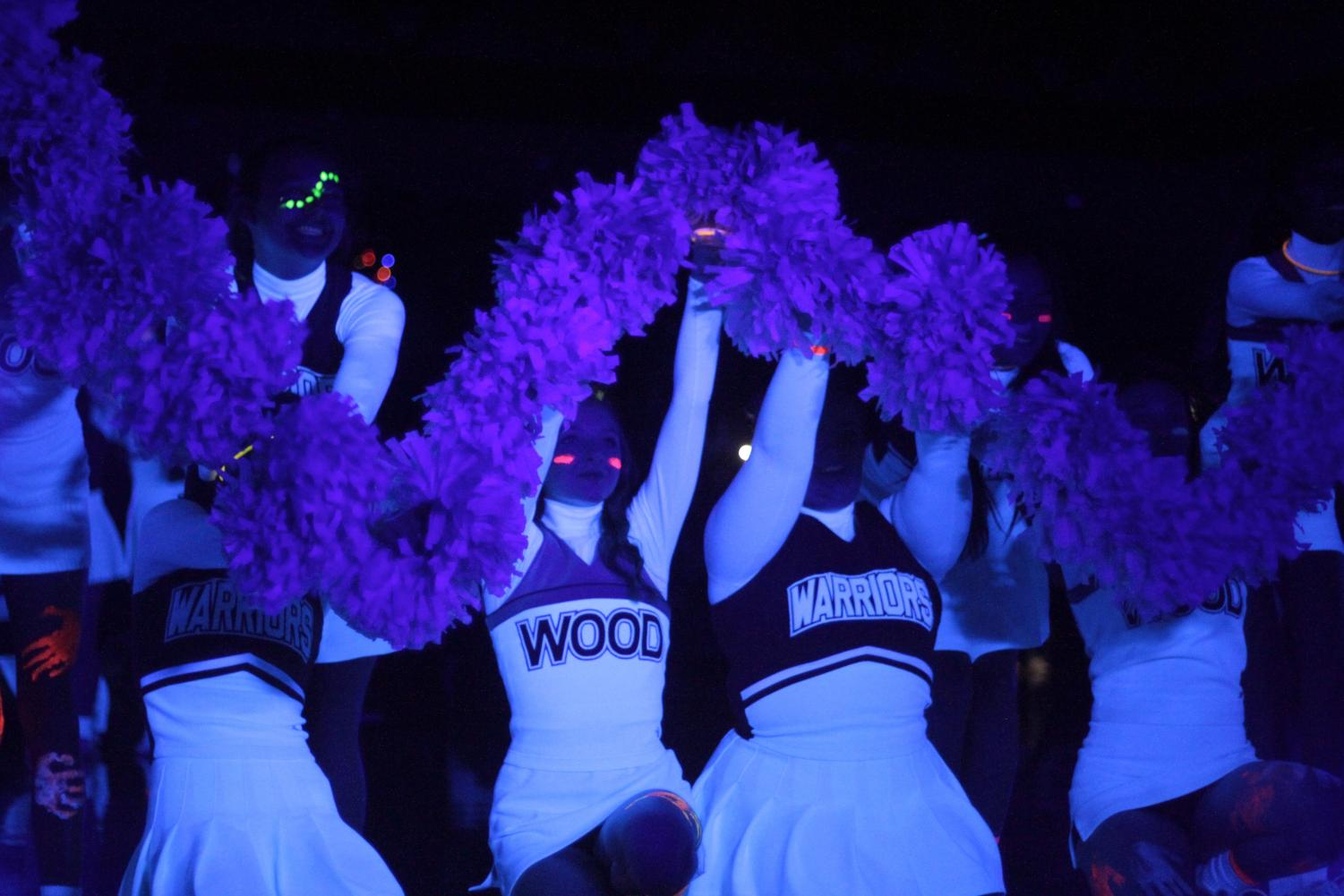 The+cheerleaders+make+a+%22w%22+with+their+pompoms.+This+was+in+the+beginning+of+their+routine+for+the+pep+rally.