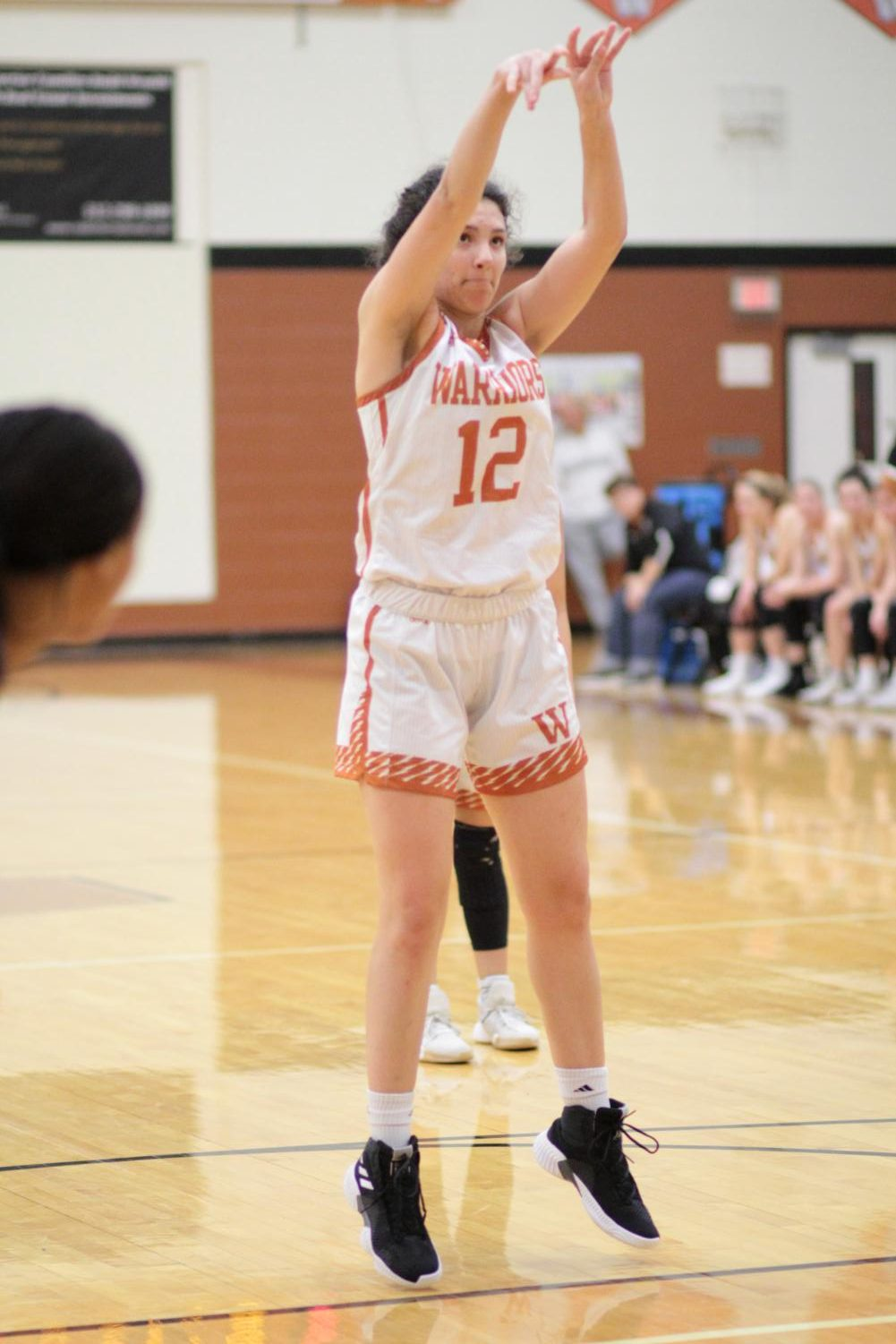Jumping%2C+Desi+Davalos+%2722+shoots+a+free+throw.+This+was+her+second+shot+and+she+ended+up+scoring+one+more+point+for+the+Warriors.+