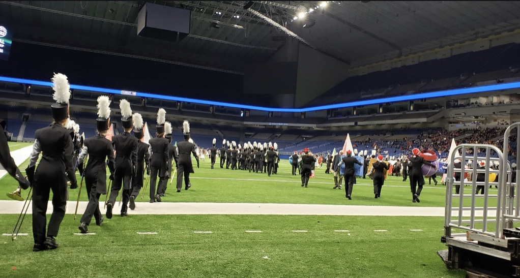 The+band+marches+onto+the+field+at+the+Alamodome%2C+ready+to+perform+during+their+11%3A30+time+slot.+Photo+courtesy+of+Ms.+Farah+Metzger.