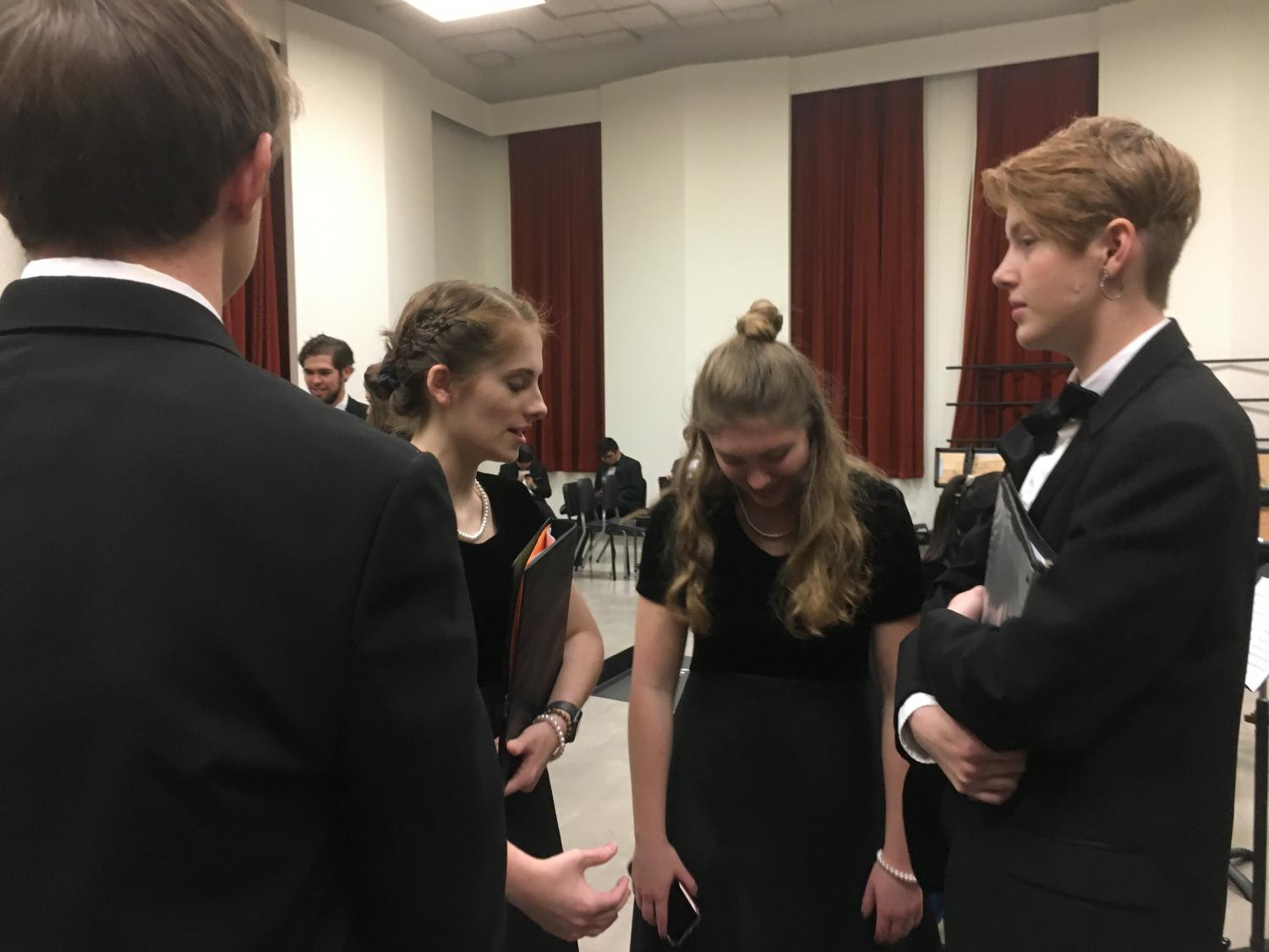 Choir+students+chat+before+preparing+to+go+onstage.++Before+the+performance%2C+they+were+able+to+rehearse+in+UT%27s+choir+room.