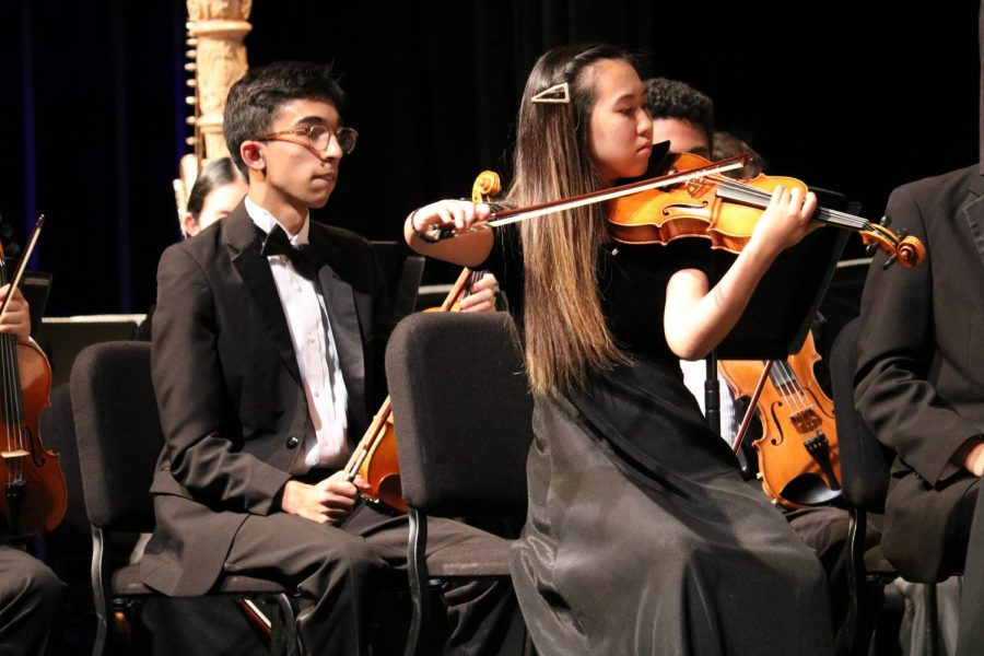 Laoise Matsumoto '21 peforms a short solo during the orchestra's rendition of Russian Christmas Music composed by Alfred Reed and arranged by Michael Story.