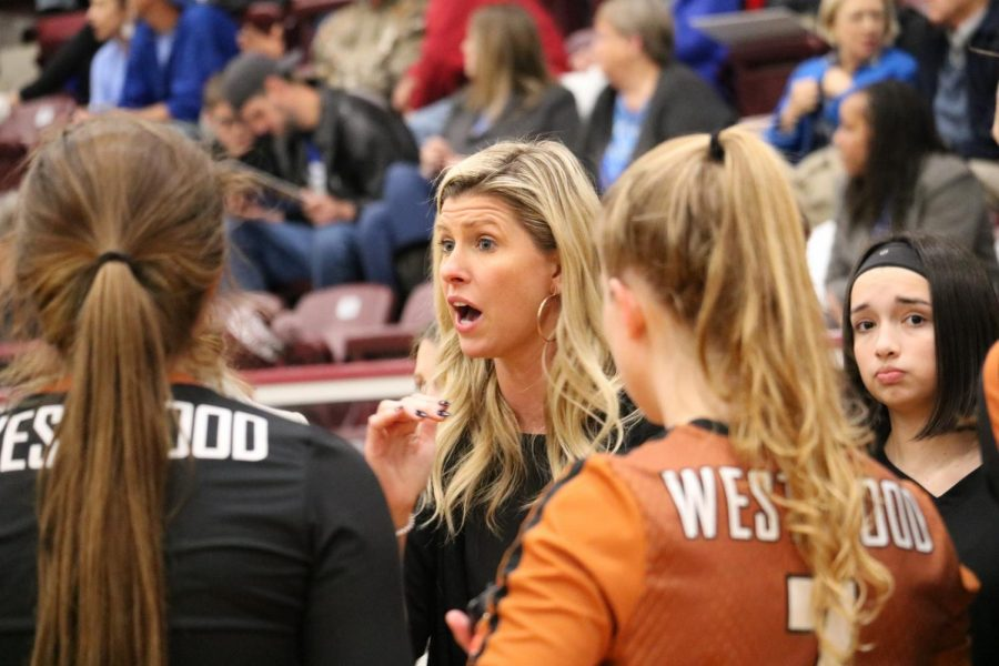 Head coach Tara Grant uses a timeout in the fourth set to help her team regroup. This set was very important for the Warriors, because if they lost it, they would lose the game.