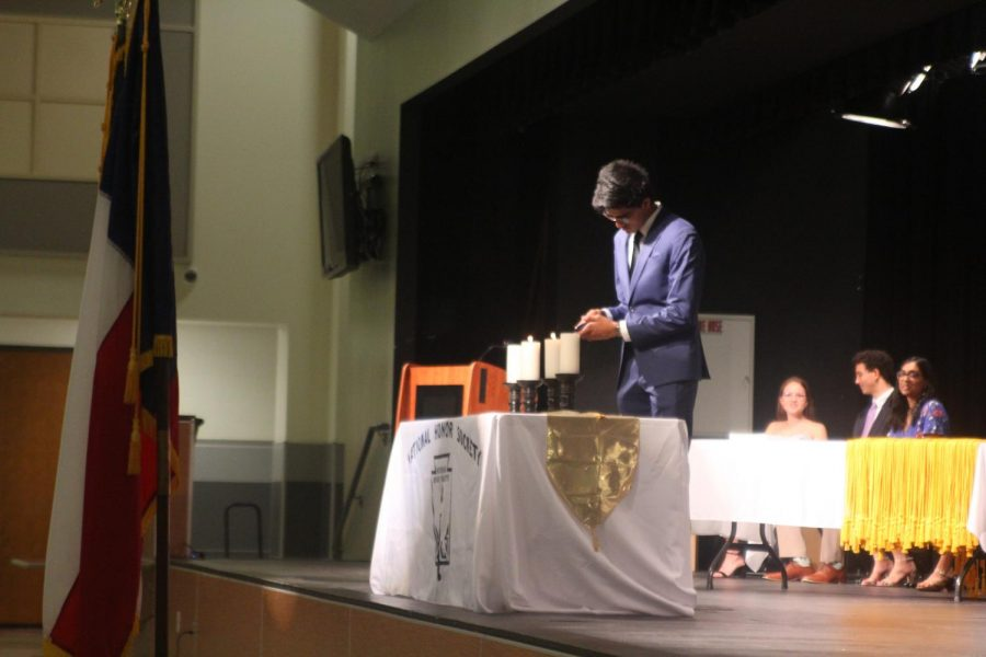 Ajit Ramamohan '20 lights one of the four candles representing the four pillars of the National Honor Society. Ramamohan serves as the NHS tutoring coordinator.