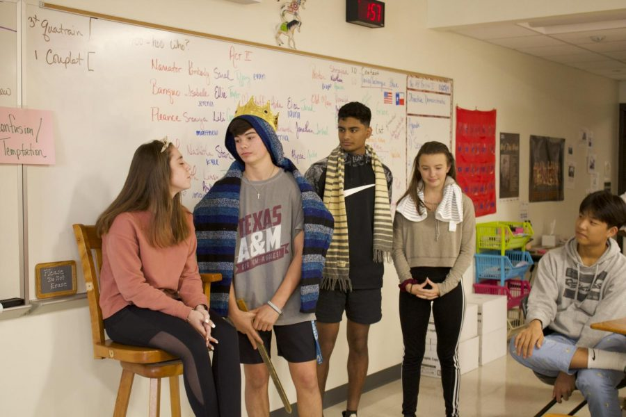 Sophomores Teddie Hall, Gus Wendland, Viswaved Uppala, and Camille Marshall reenact Act III, Scene IV of Macbeth. In this scene, after hiring a thief to brutally bash in Banquo's head, Wendland is celebrating with a blissful banquet.