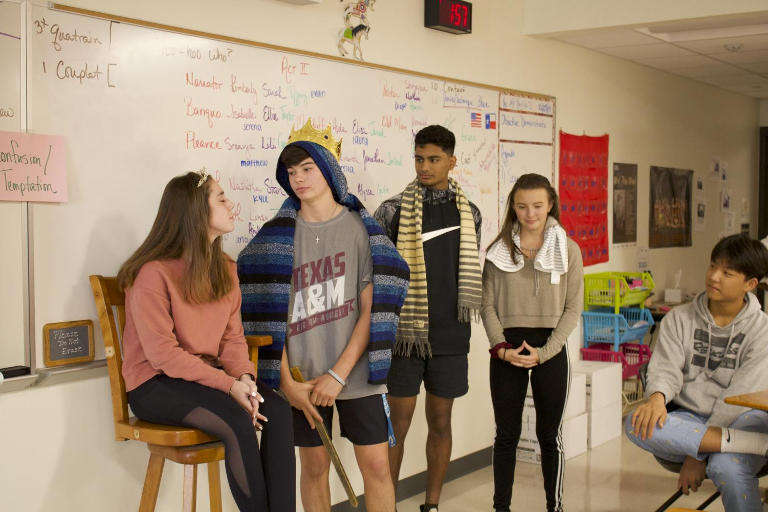 Sophomores+Teddie+Hall%2C+Gus+Wendland%2C+Viswaved+Uppala%2C+and+Camille+Marshall+reenact+Act+III%2C+Scene+IV+of+Macbeth.+In+this+scene%2C+after+hiring+a+thief+to+brutally+bash+in+Banquo%27s+head%2C+Wendland+is+celebrating+with+a+blissful+banquet.