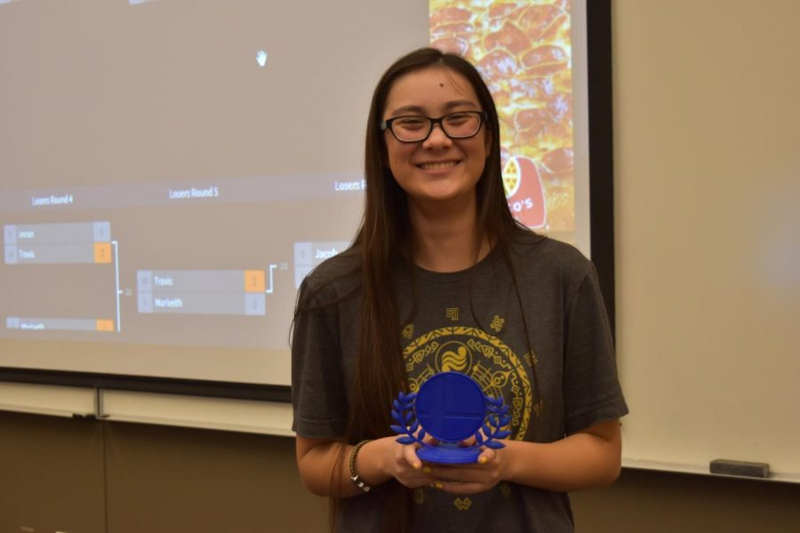 President of Smash Club Olivia Bowen '20 holds her trophy. Bowen won the solo tournament after several rounds against other players.