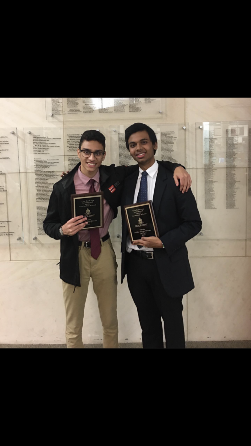 Pranav Kulkarni '20 and Anand Singh '21 pose for a picture.
