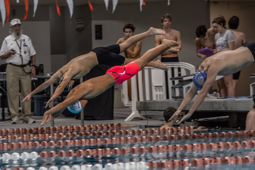 Raymond+Wang+%2722+diving+into+the+water.+With+the+momentum+from+his+dive%2C+Wang+was+able+to+get+a+head+start%2C+allowing+him+to+place+second+in+his+heat.+