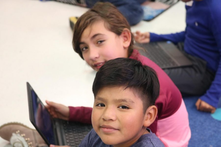Students smile after progressing to the next stage of the Minecraft coding activity.