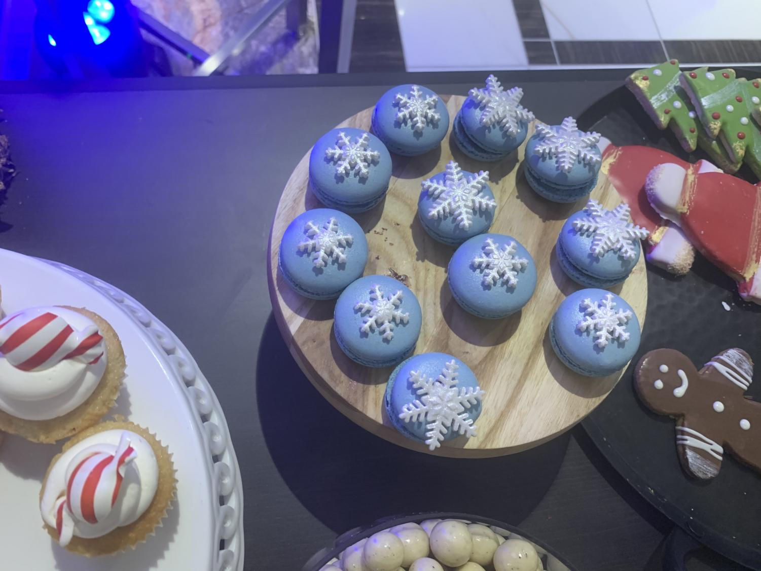 One+of+the+more+visually+appealing+desserts%2C+the+macaroons+constantly+ran+out.++There+were+various+colors+that+ran+with+the+winter+theme%2C+including+the+blue+chocolate+macaroon+with+a+candy+snowflake+on+top.