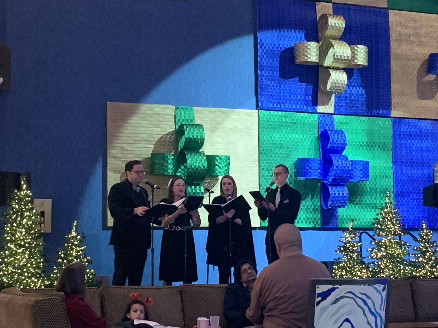 Chorus+Austin+performs+holiday+music+to+entertain+the+many+guests+enjoying+the+evening%27s+festivities.+The+stage+was+decorated+to+match+the+theme+as+well.