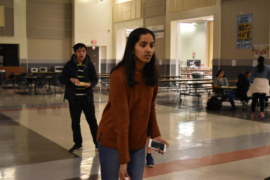 Srivaishnavi Marreddy '22 throws a ping-pong ball while playing fish pong. Small prizes were given to students who scored points in the activity.