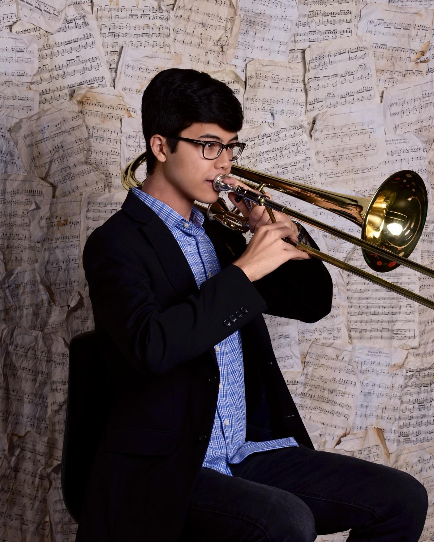 Aaron+Slack+%E2%80%9920+poses+with+his+trombone+for+a+portrait.+%0APhoto+Courtesy+of+Aaron+Slack+%2720.