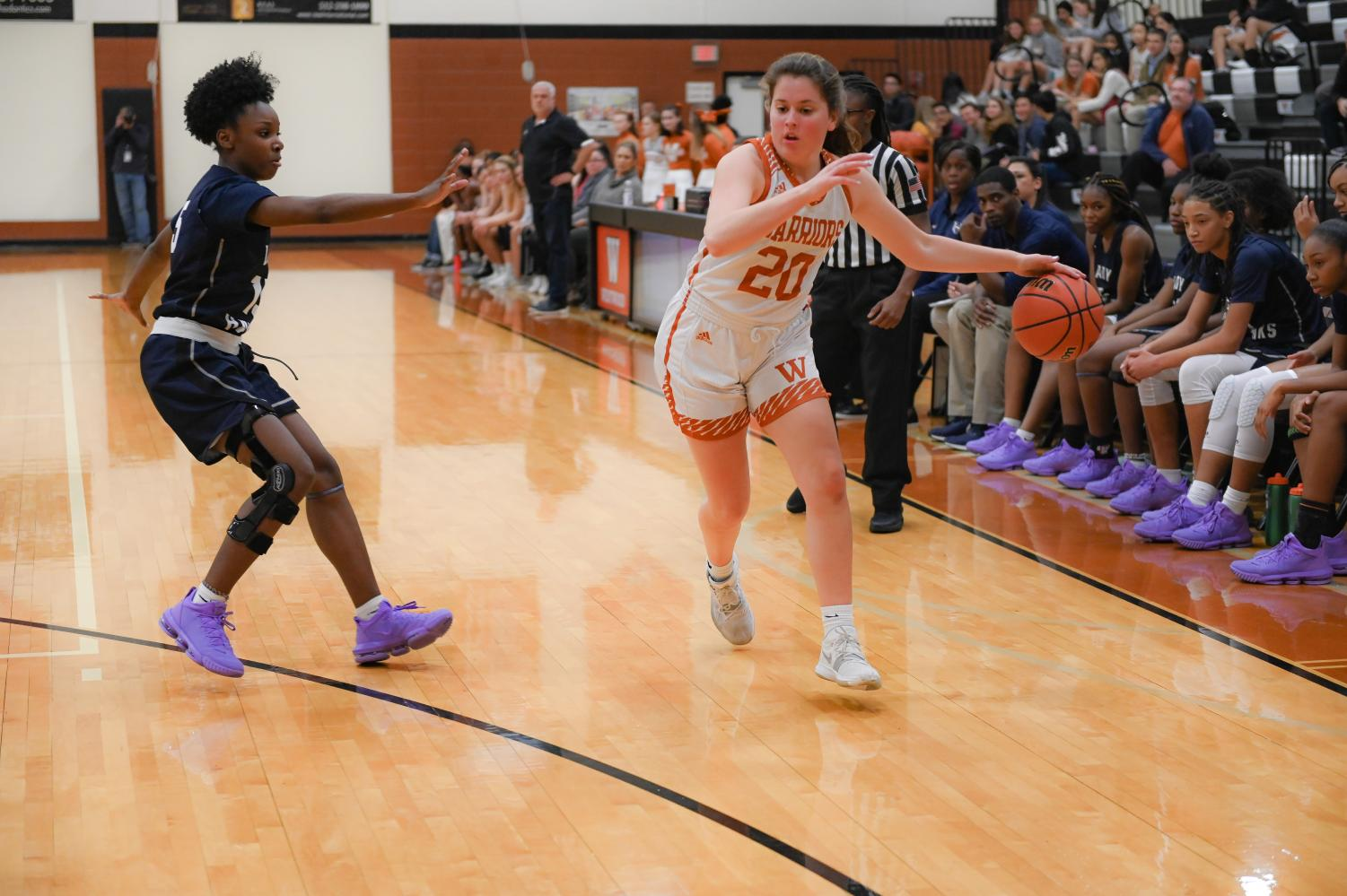 Peyton+Halley+%2721+dribbles+past+the+defense.+Halley+plays+as+guard+for+the+varsity+team.