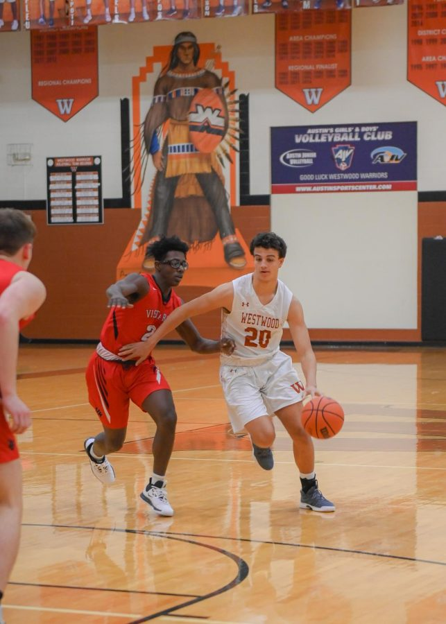 Christian Robinson '20 dribbles past the defense. Robinson plays as power forward and center for the team.
