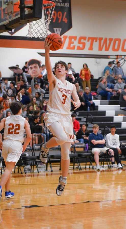 Towards the end of halftime Quinn Farquharson '20 and the rest of the team warm up by shooting layups for the second half of the game. As the Warriors were in a close lead, the energy was high for the second half.