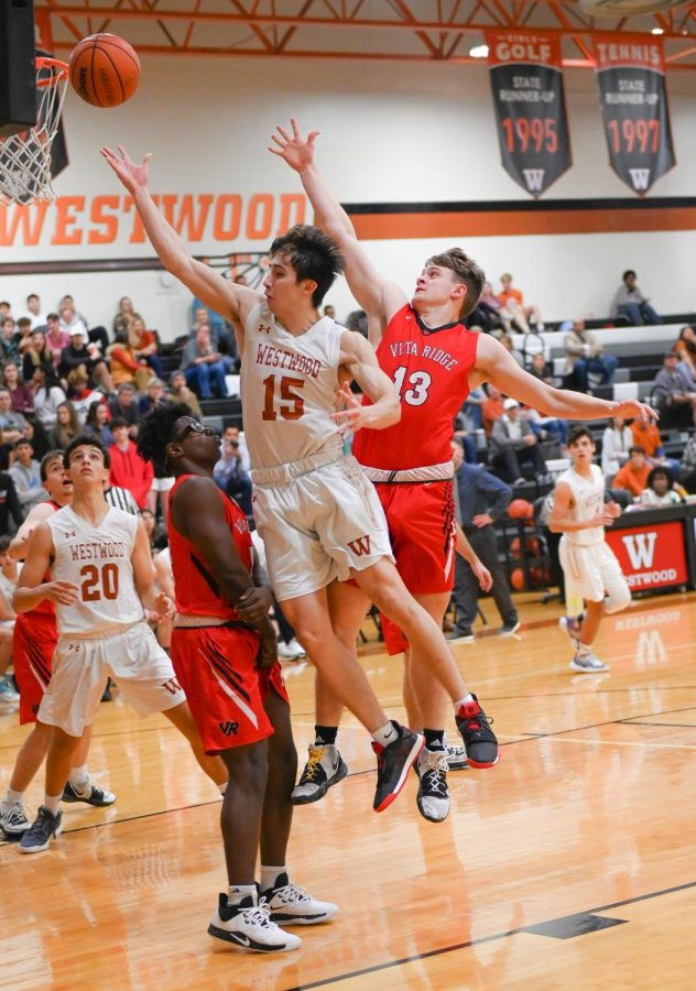 Attempting to catch a rebound after a missed shot, Santi Campos '20 jumps in the air. Campos plays as shooting guard for the team.