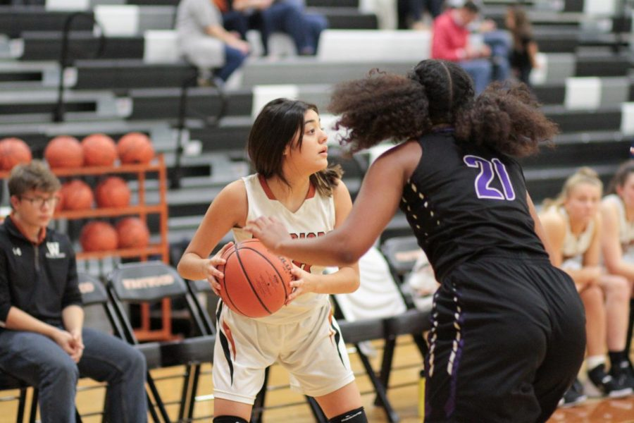 Kaylina Medina '22 looks to her teammates to see who to pass the ball to. This was during the third quarter and the Warriors were behind and trying to even out the score.
