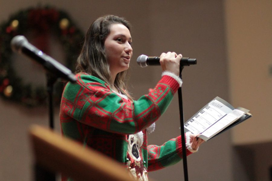 Sarah Sherwood '20 announces the songs that the Chorale is going to sing. Sherwood and Co-President Rachel Rusch '20, announced each group before they sing.