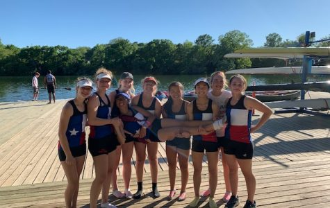 Hanna Hoogendam '21 poses with her team in front of their boats. Photo Courtesy of Hanna Hoogendam '21