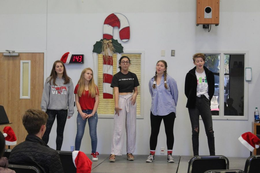 Joining in harmony, seniors Rachel Rusch, Elsa Hughes, Katya Lopez, Nicole Boisseau, and Laney McFadden perform a memorable rendition of the classic ABBA hit 'Super Trouper.'