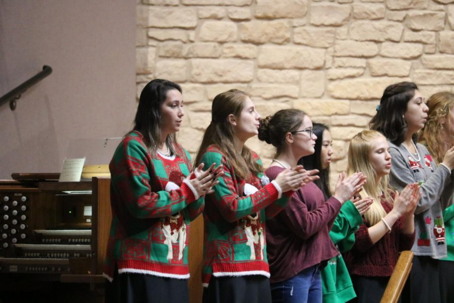 The newly formed Audacity choir performs 'White Winter Hymnal' in Christmas sweaters.