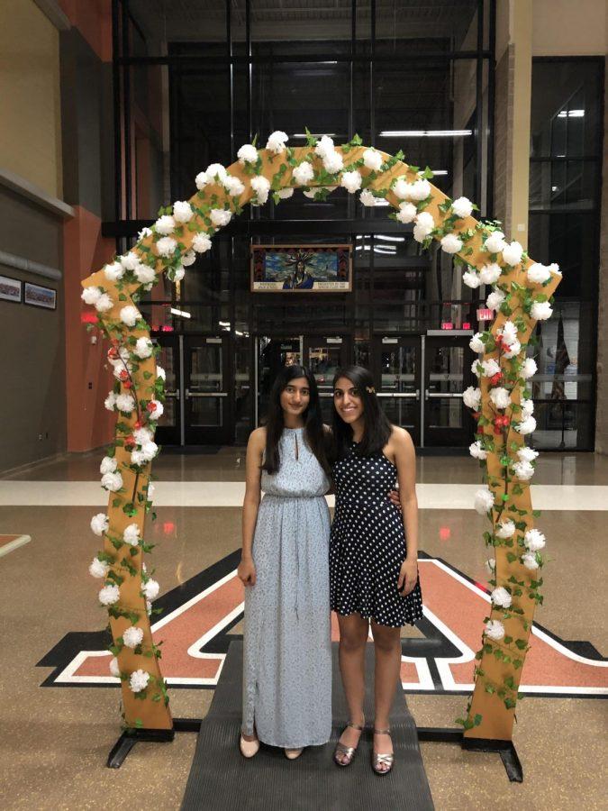 Rehana Shaik '20 and Anaita Merchant '20 pose in the archway set up for the ball.  Photo courtesy of Anaita Merchant