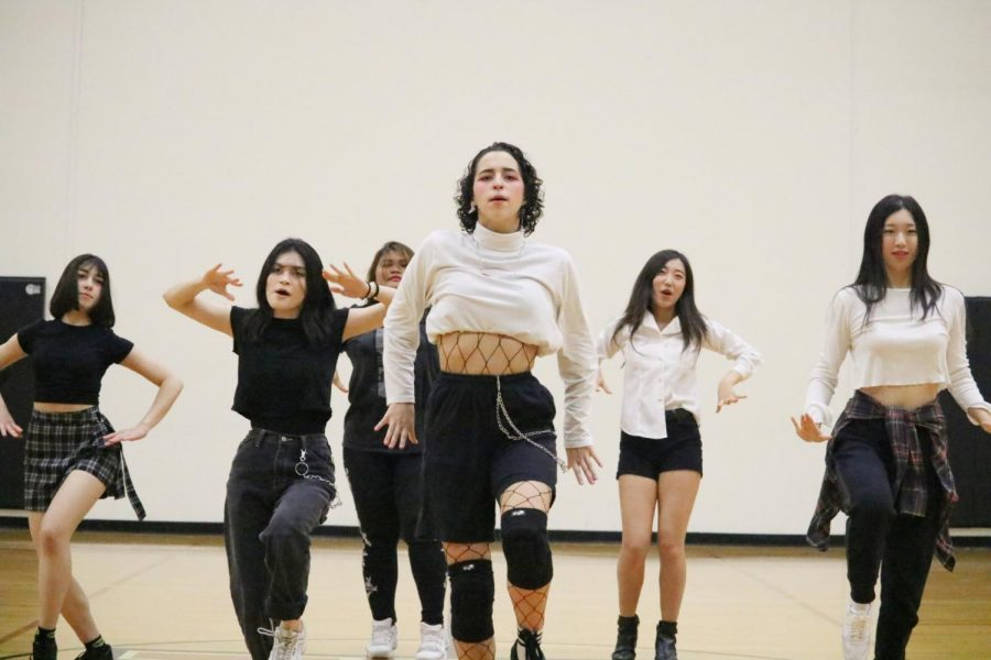 Lola Fernandez '22 and other members of KPop club dance to 'Adios' by Everglow. 'Adios' is part of Everglow's album 'Hush'.