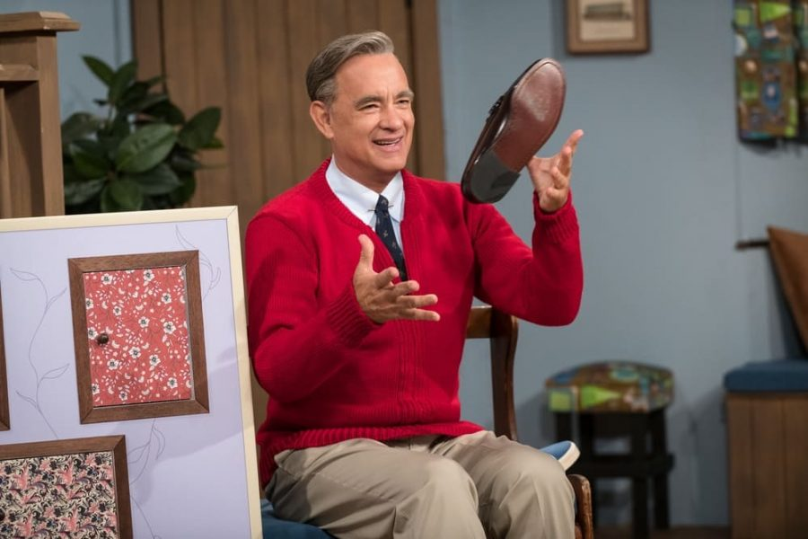 Fred Rogers, played by Tom Hanks, is shown in the middle of his signature opening scene for his show. Photo Courtesy of Sony Pictures.