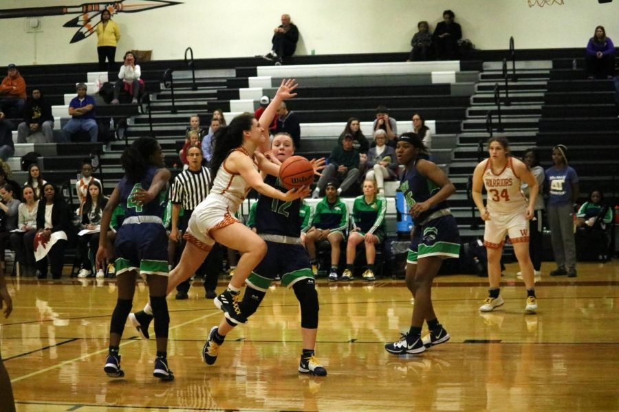 Desi Davalos '22 leaps into the air in hopes to bring the lady warriors up two points. Davalos was unable to make the ball go in but was not discouraged and continued to play her heart out.